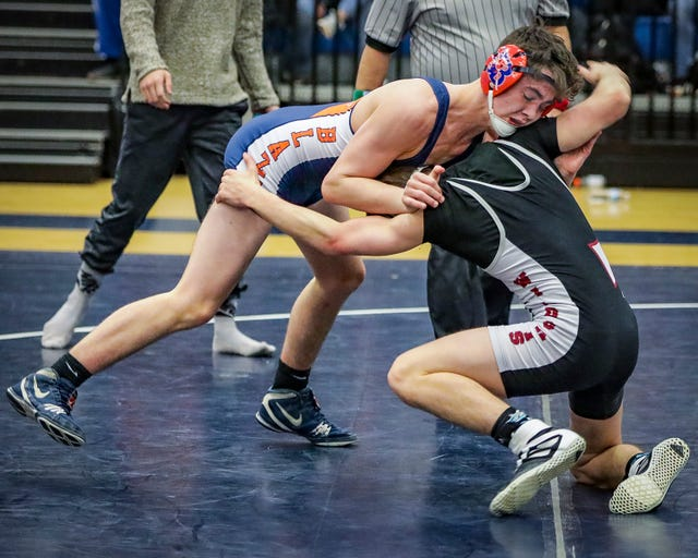 Blackman's Aaron Fisher battles Tullahoma's Landen Willette in the 145-pound division in the region finals Thursday.