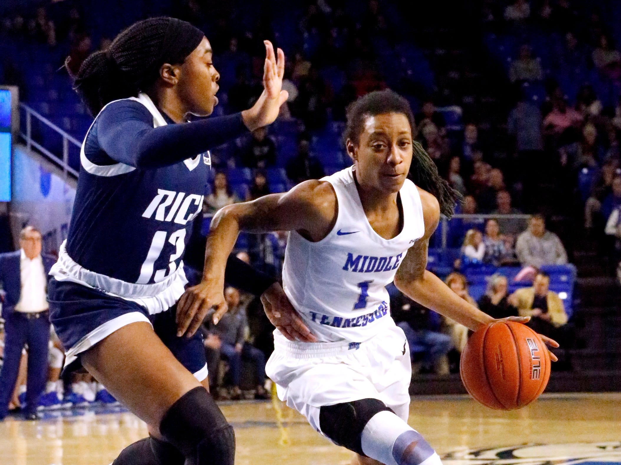 MTSU's guard A'Queen Hayes (1) drives to the basket as Rice's guard Erica Ogwumike (13) guards her on Thursday Jan. 24, 2019.
