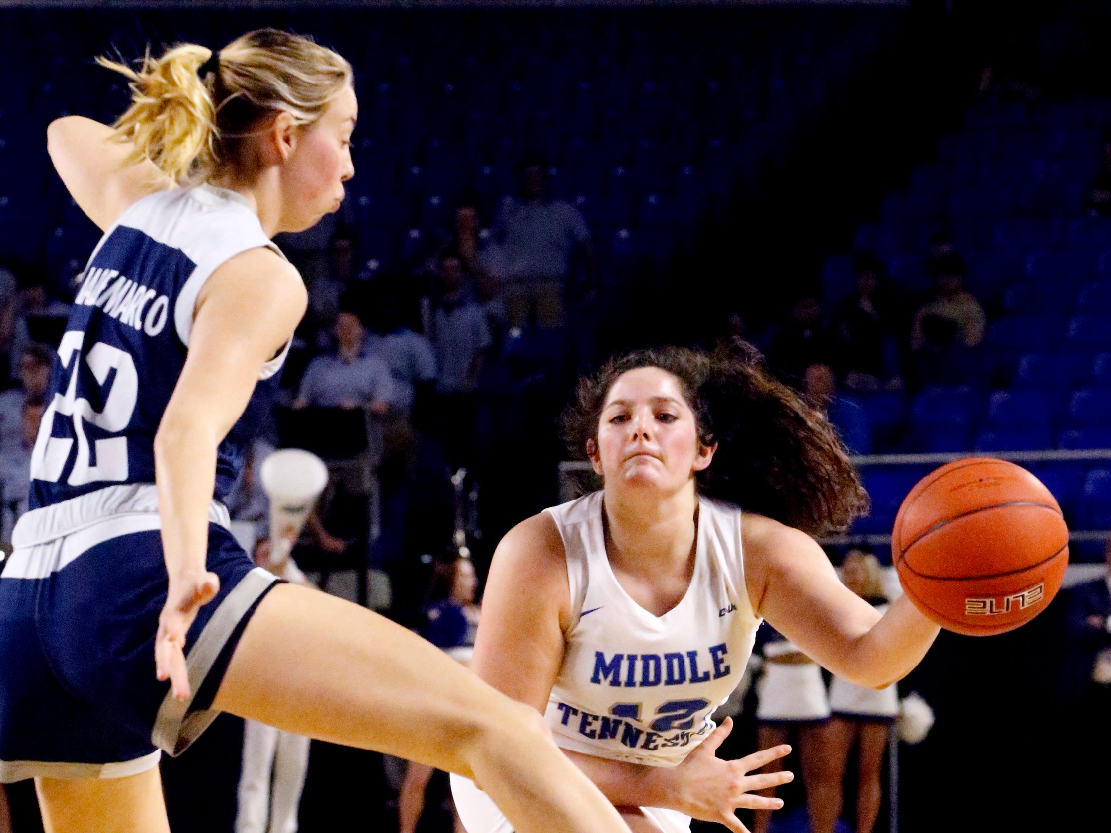 MTSU's guard Jess Louro (12) passes the ball around Rice's center Nancy Mulkey (32) on Thursday Jan. 24, 2019.