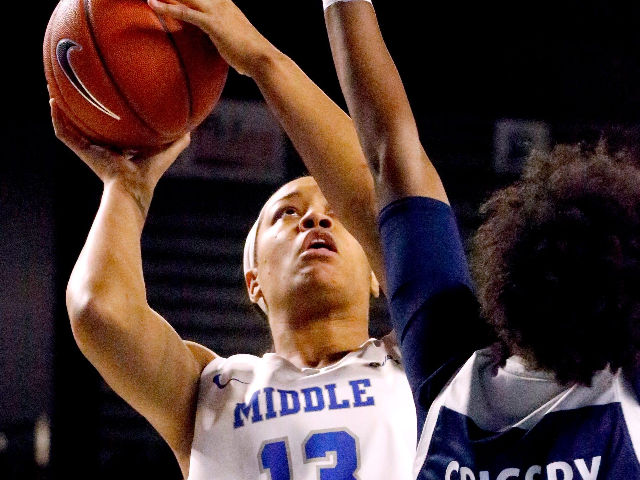 MTSU's forward Jordan Majors (13) shoots the ball as Rice's guard Lauren Grigsby (5) guards her on Thursday Jan. 24, 2019.