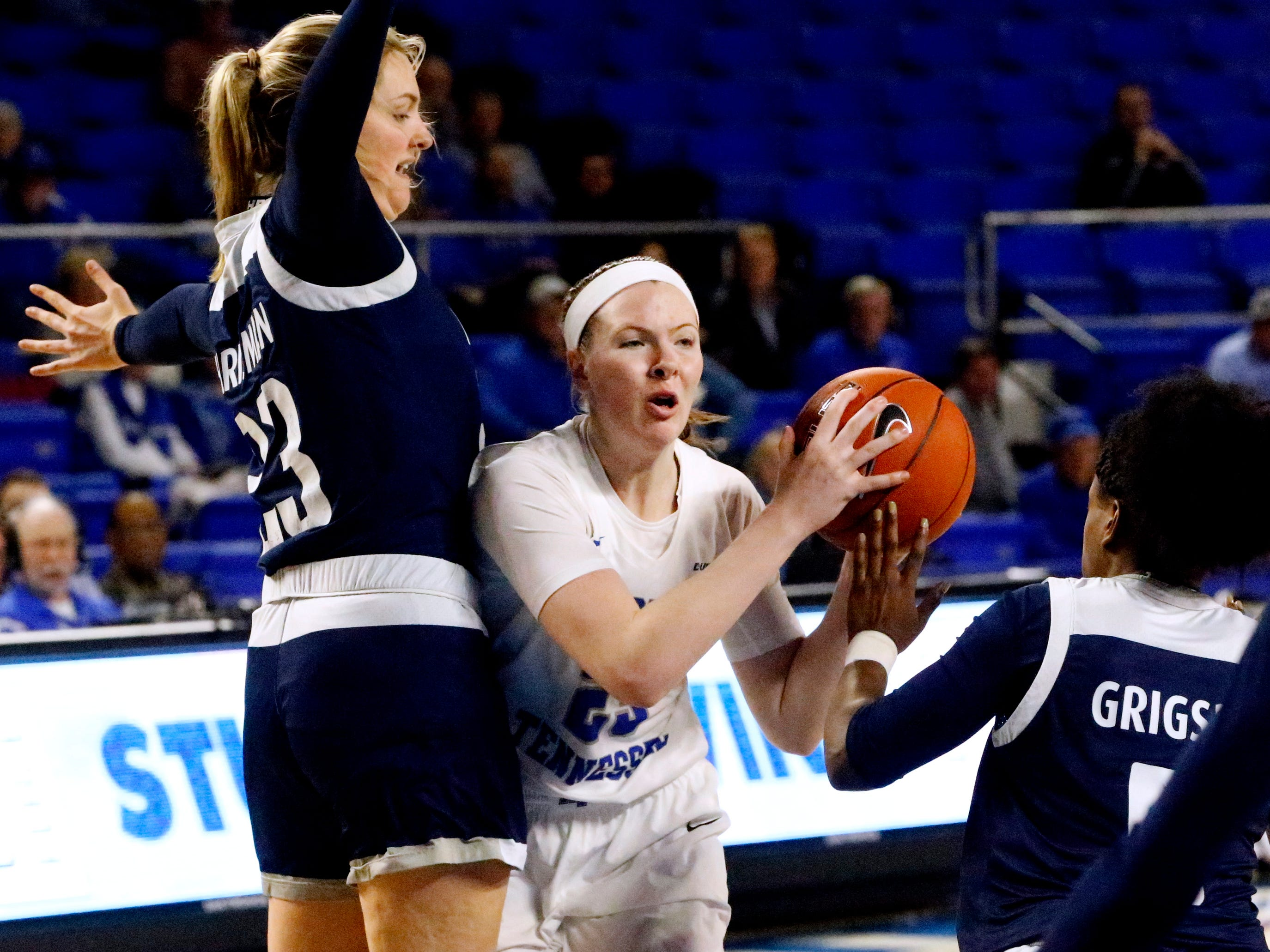 MTSU's guard Alexis Whittington (23) looks to pass the ball as Rice's center Alexah Chrisman (23) and Rice's guard Lauren Grigsby (5) both cover her on Thursday Jan. 24, 2019.