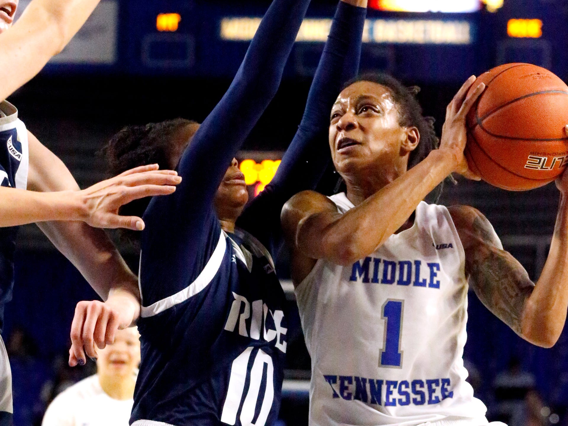 MTSU's guard A'Queen Hayes (1) goes to shoot the ball as Rice's guard Jasmine Smith (10) guards her on Thursday Jan. 24, 2019.