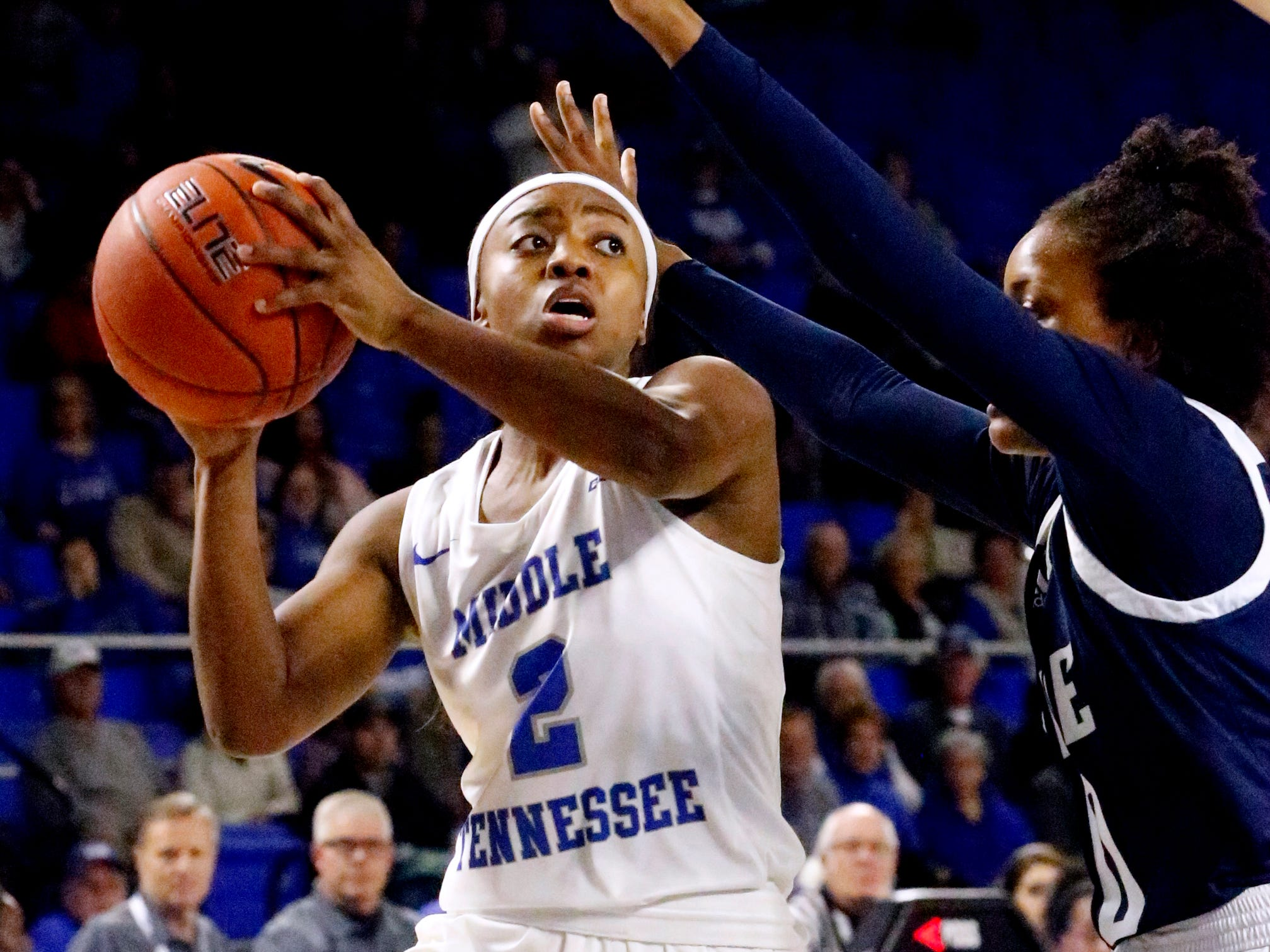 MTSU's guard Taylor Sutton (2) passes the ball as Rice's guard Jasmine Smith (10) guards her on Thursday Jan. 24, 2019.