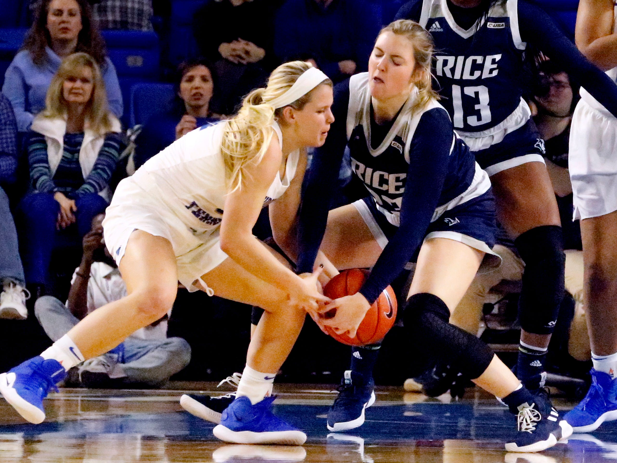 MTSU's guard Katie Collier (14) and Rice's center Nancy Mulkey (32) fight for position of the ball on Thursday Jan. 24, 2019.