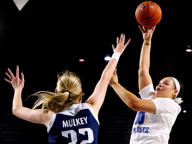 MTSU's forward Alex Johnson (00) shoots the ball as Rice's center Nancy Mulkey (32) guards her on Thursday Jan. 24, 2019.