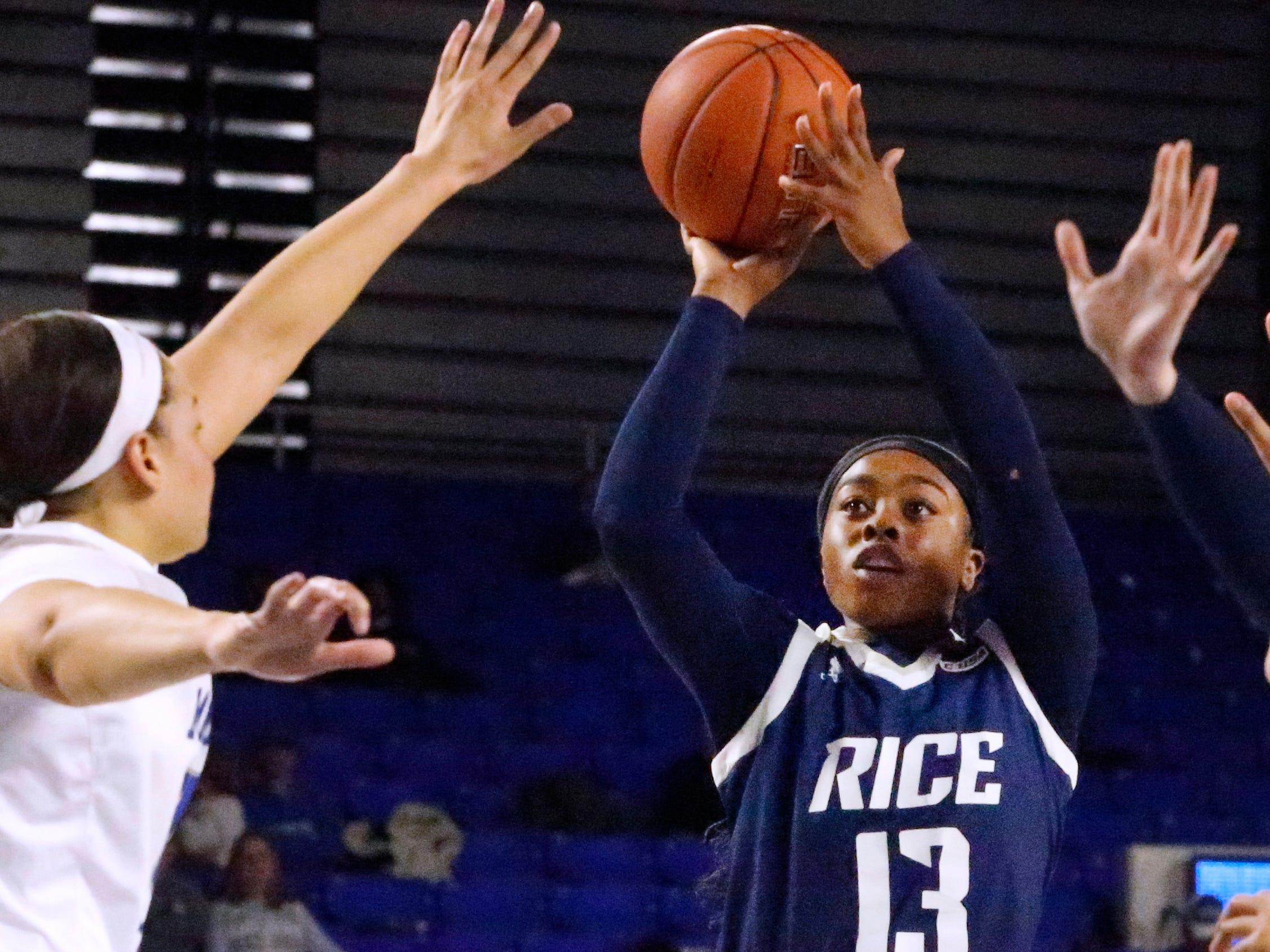 Rice's guard Erica Ogwumike (13) shoots the ball as MTSU's forward Alex Johnson (00) guards her on Thursday Jan. 24, 2019.