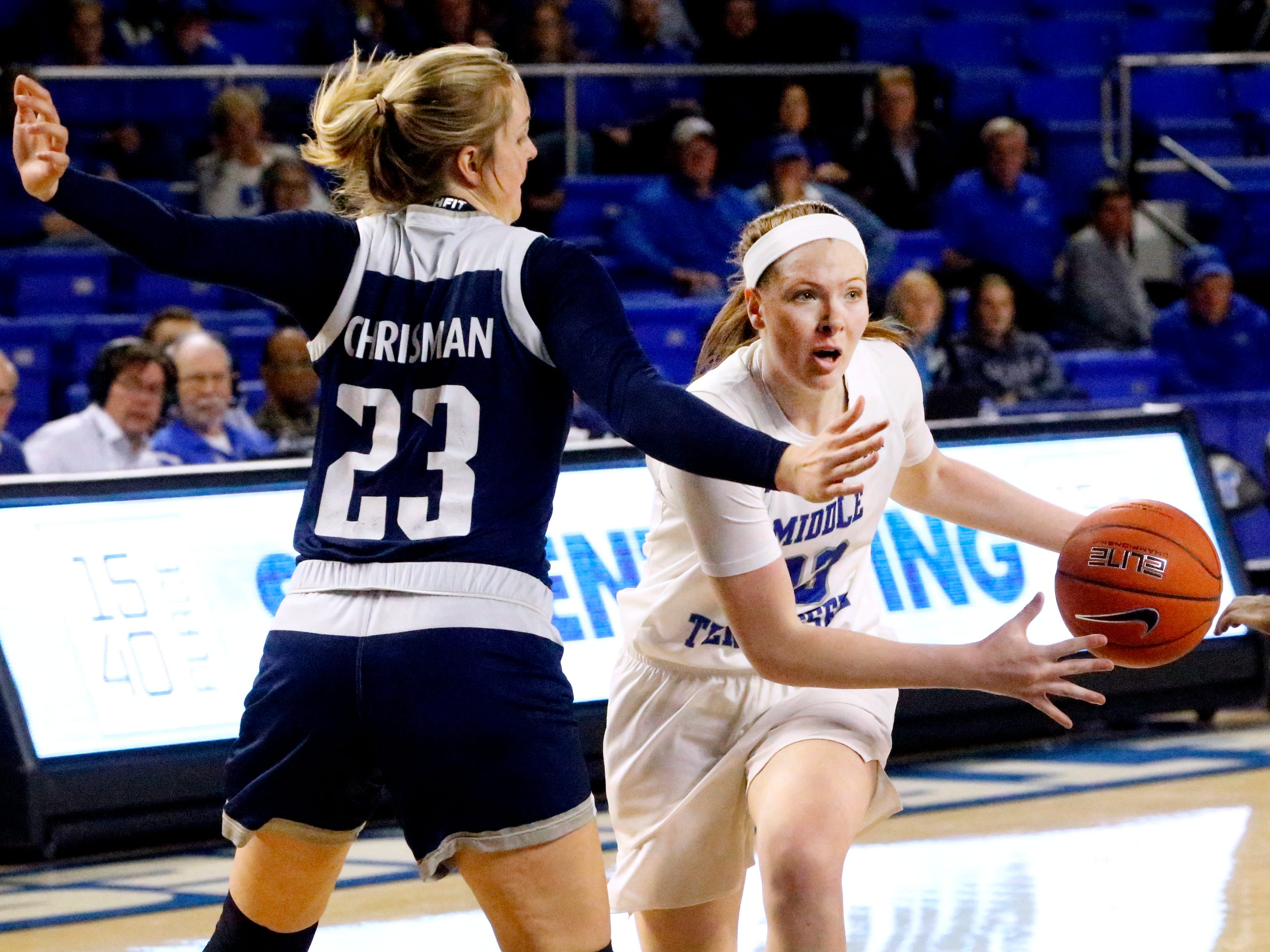 MTSU's guard Alexis Whittington (23) drives to the basket as Rice's center Alexah Chrisman (23) guards her on Thursday Jan. 24, 2019.
