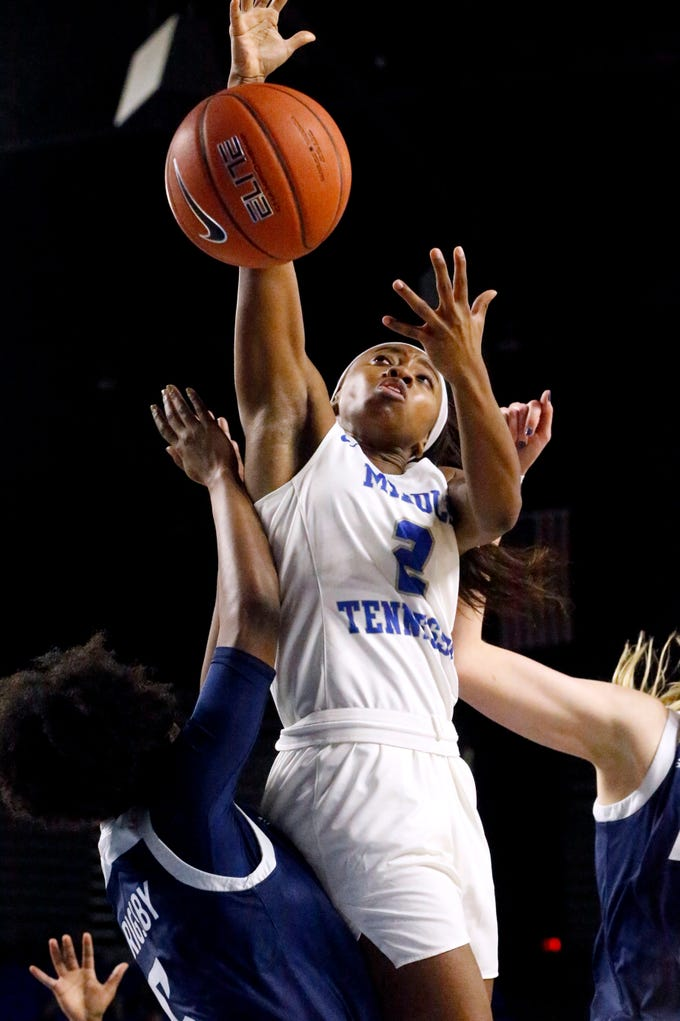 MTSU's guard Taylor Sutton (2) goes up for a shot as she get fouled by a Rice player on Thursday Jan. 24, 2019.
