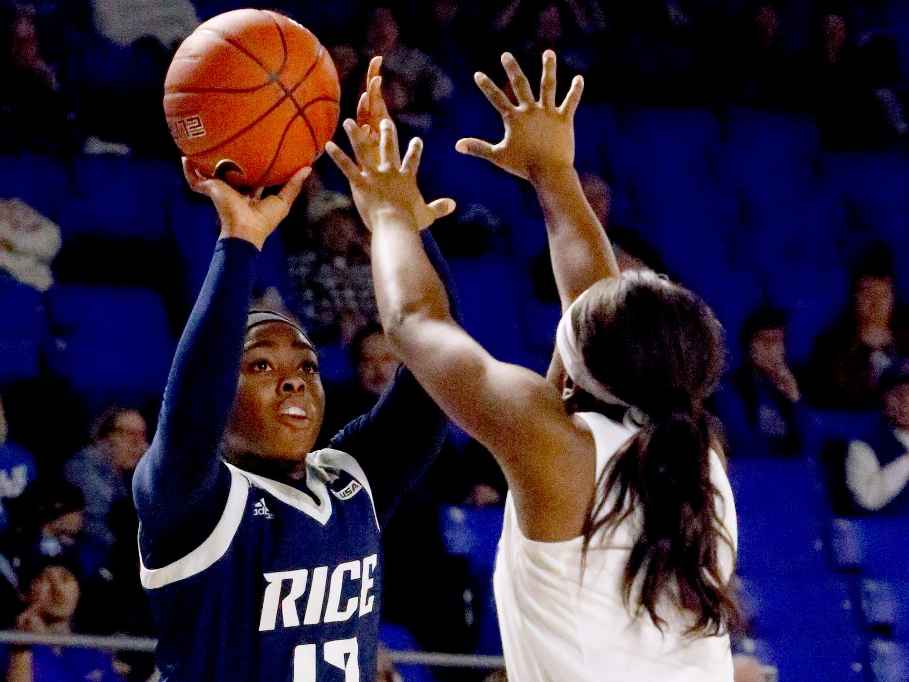 Rice's guard Erica Ogwumike (13) shoots the all as MTSU's guard Taylor Sutton (2) guards her on Thursday Jan. 24, 2019.