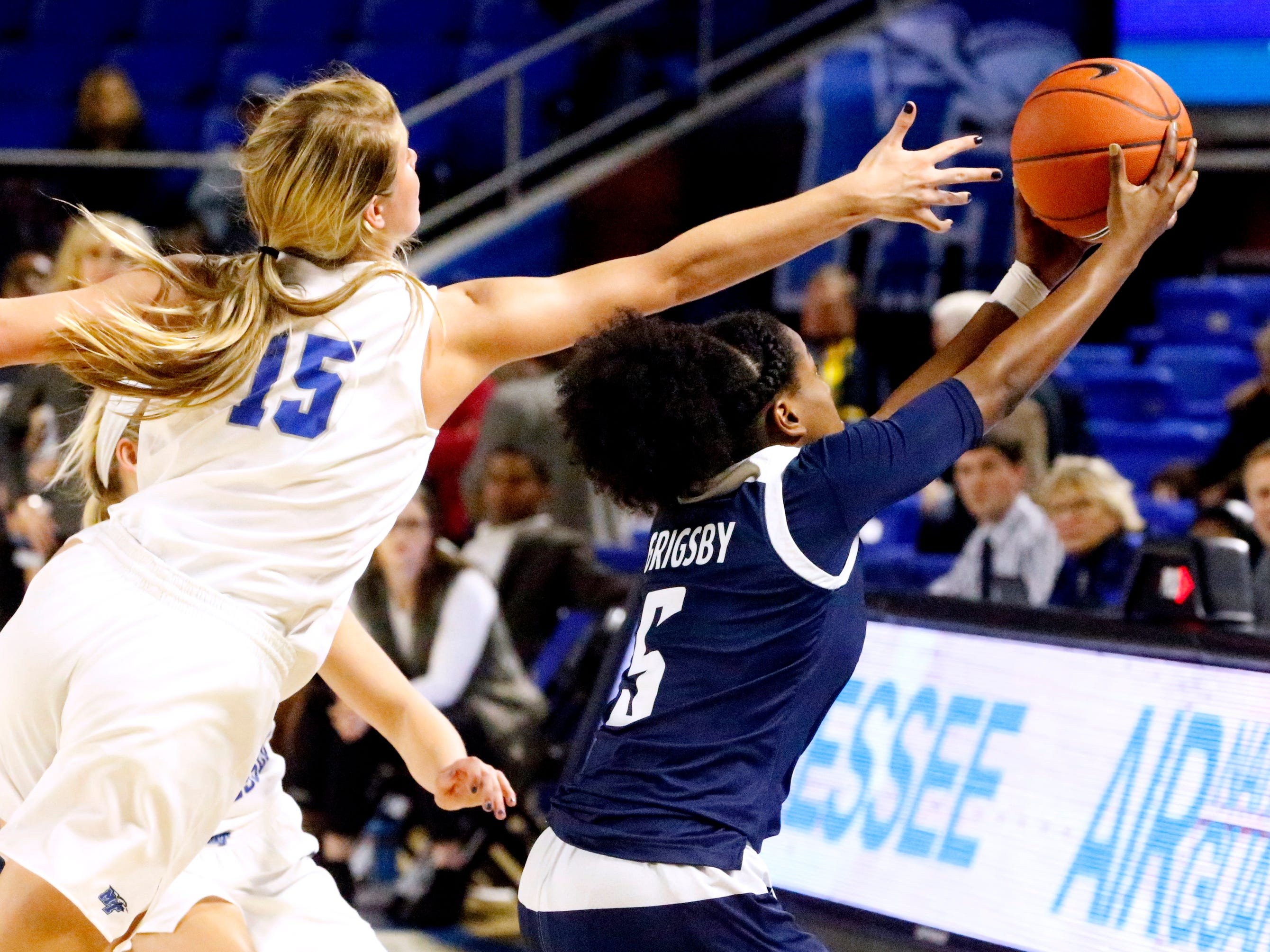 MTSU's guard Anna Jones (15) and Rice's guard Lauren Grigsby (5) both go after a pass intended for Grigsby on Thursday Jan. 24, 2019.