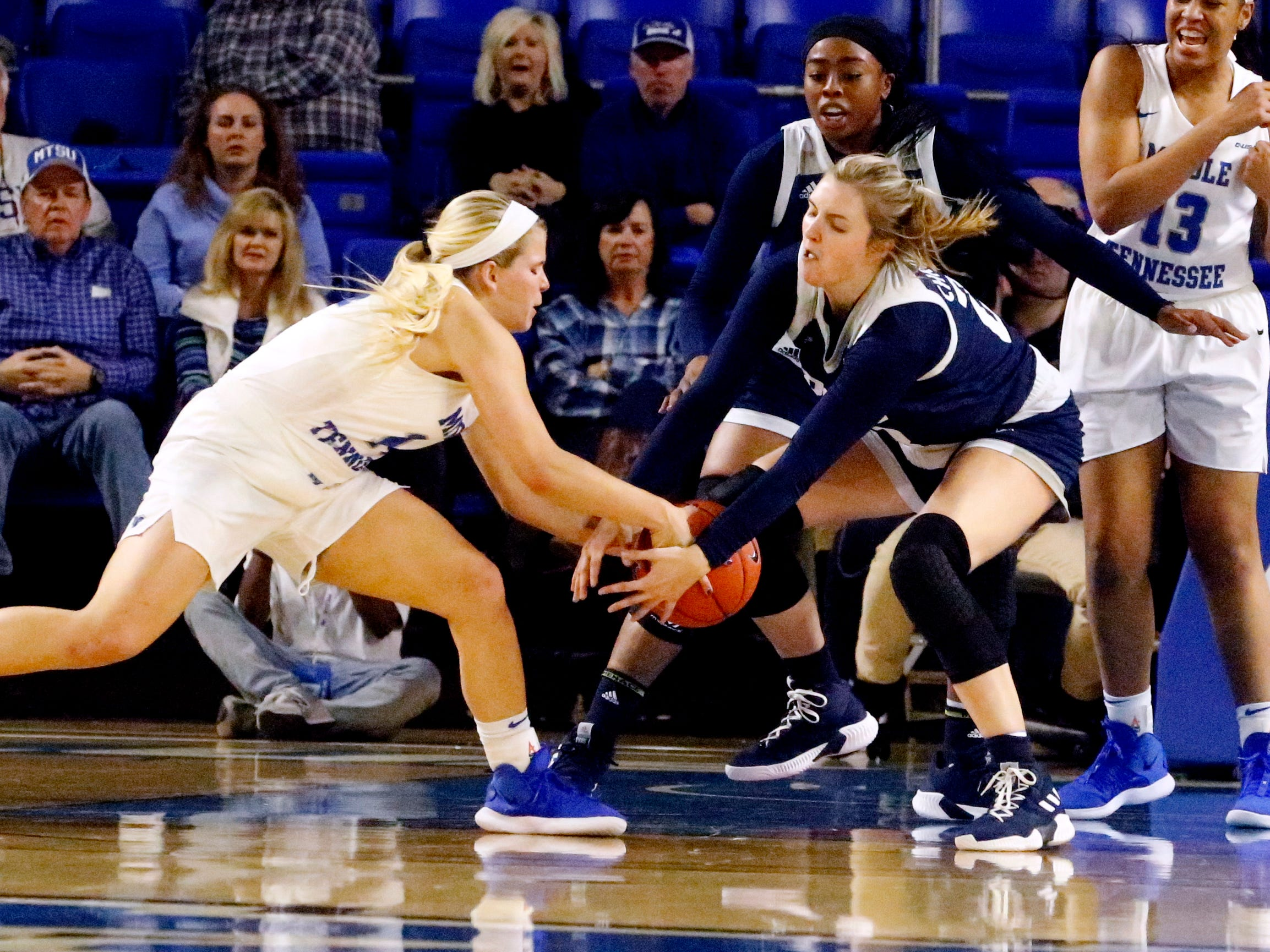 MTSU's guard Katie Collier (14) and Rice's center Nancy Mulkey (32) both go after the ball that Collier looses control of on Thursday Jan. 24, 2019.