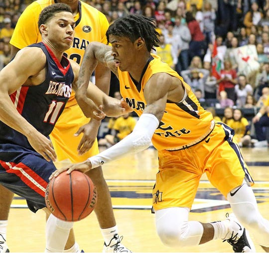 Murray State's Ja Morant drives against Belmont's Kevin McClain (11) during their Jan. 24 regular season meeting. Belmont won 79-66.