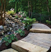 Outdoor projects don't have to be complicated. This walkway is part of a backyard quiet space.