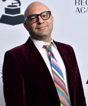 "Daniel Tashian walks the red carpet at the Recording Academy's annual Grammy nominee party Jan. 24 in Nashville. Tashian co-produced Kacey Musgraves' album ""Golden Hour."""