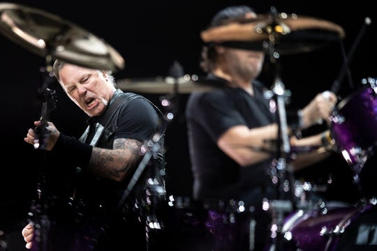 Metalica vocalist/guitarist James Hetfield, left, and drummer Lars Ulrich perform during the WorldWired Tour at Bridgestone Arena in Nashville, Tenn., Thursday, Jan. 24, 2019.