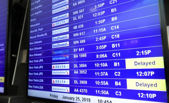 Nashville International Airport's video screen shows some delays among arriving and departing flights on Friday, Jan. 25, 2019.