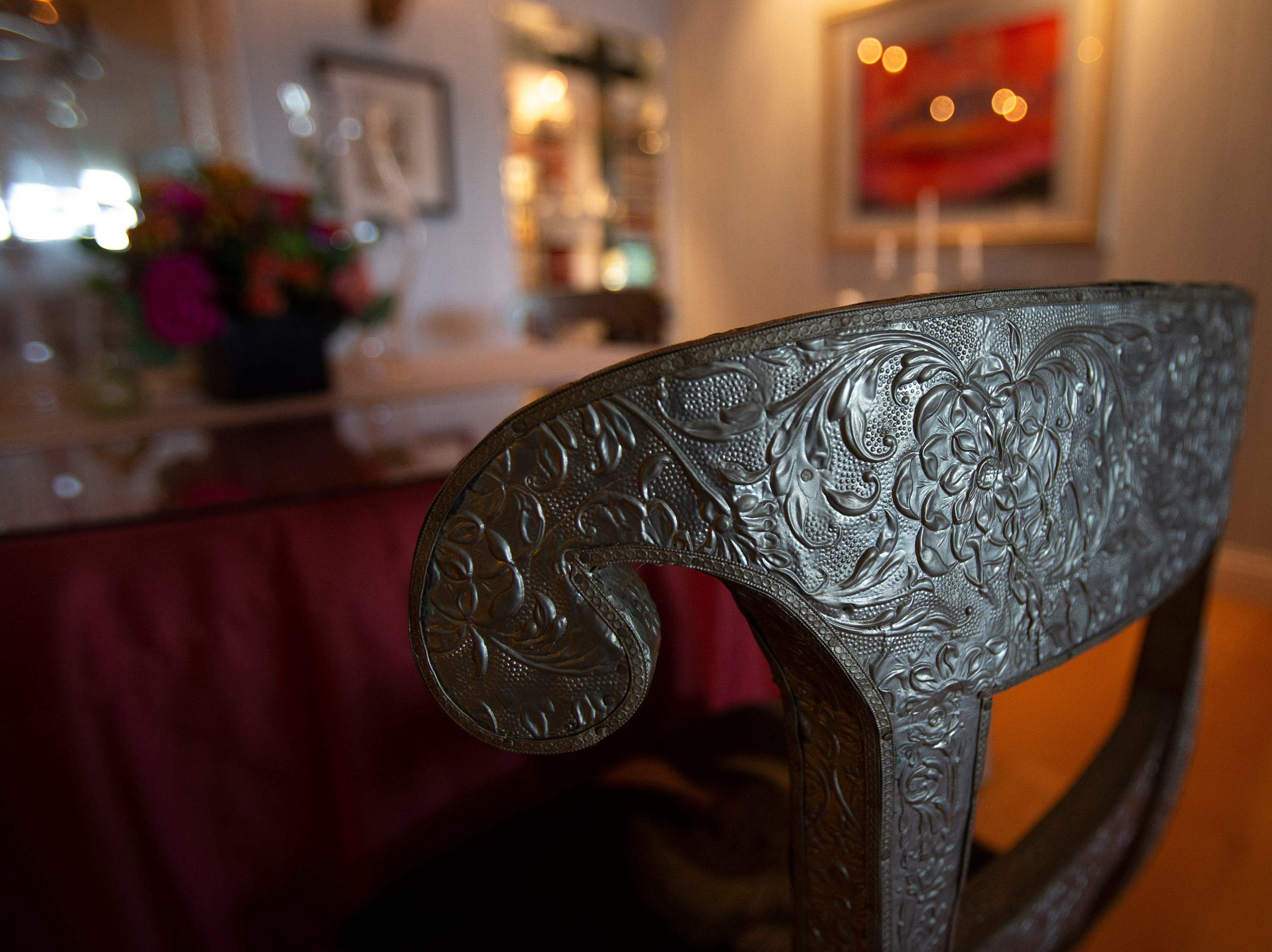 A coin silver dining room chair owned by Linda LaRue Brown is displayed at her Aqualane Shores home which will be featured in the Naples House and Garden Tour, Thursday, Jan. 24, 2019, in Naples.