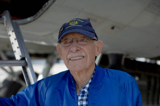 Robert Naum, 95, with a the B-17 Flying Fortress during the annual Collings Foundation's Wings of Freedom tour at the Naples Airport on January 25, 2019. Naum served in the U.S. Army Air Force and flew in 29 missions.