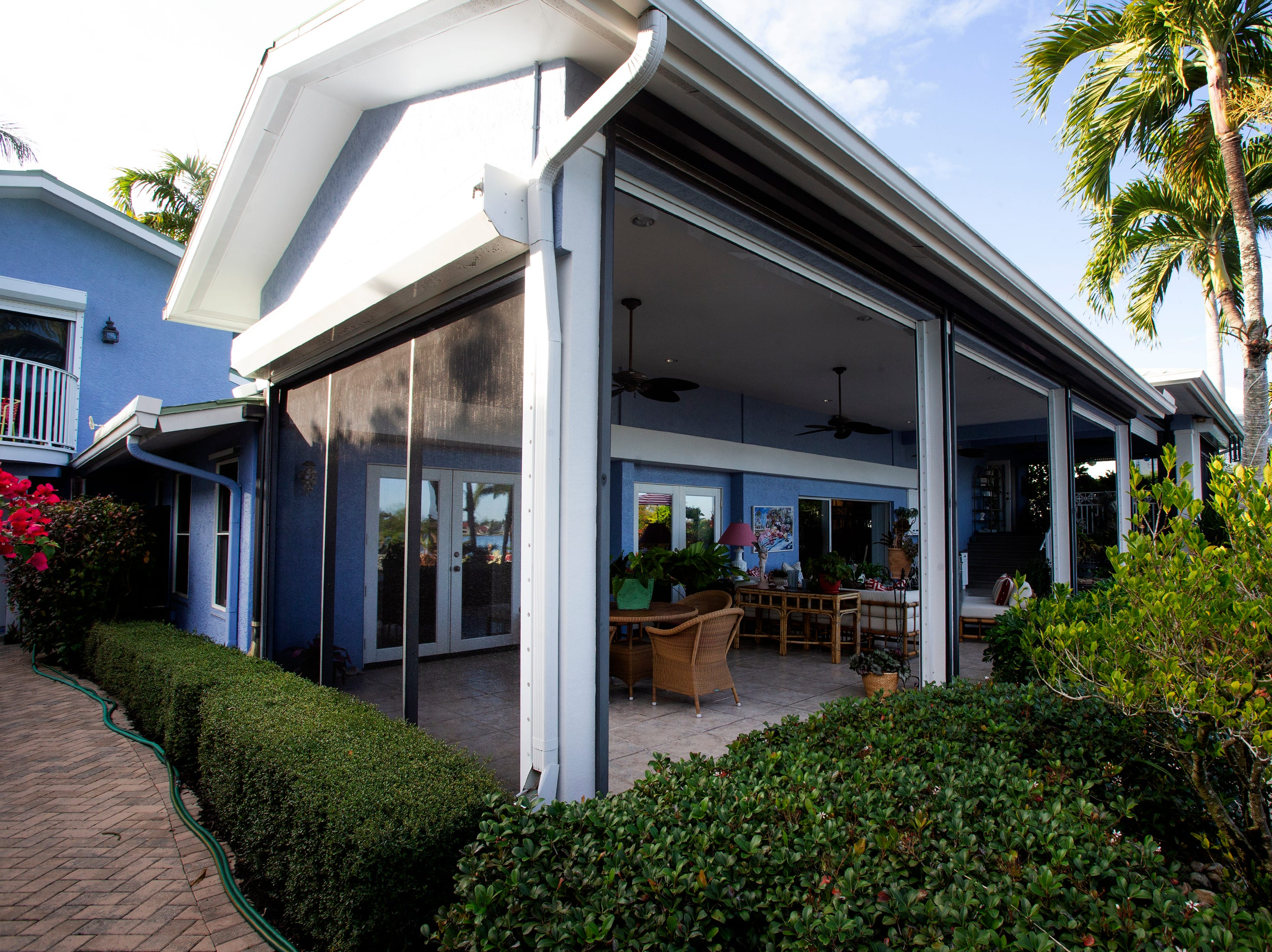 The back of a waterfront Aqualane Shores home which will be featured in the Naples House and Garden Tour is pictured, Thursday, Jan. 25, 2019, in Naples.