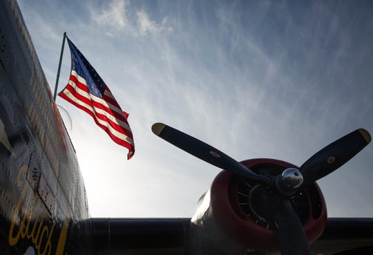 An American flag flies on a B-24J Liberator during the annual Collings Foundation's Wings of Freedom tour at Naples Airport on Friday, Jan. 25, 2019.