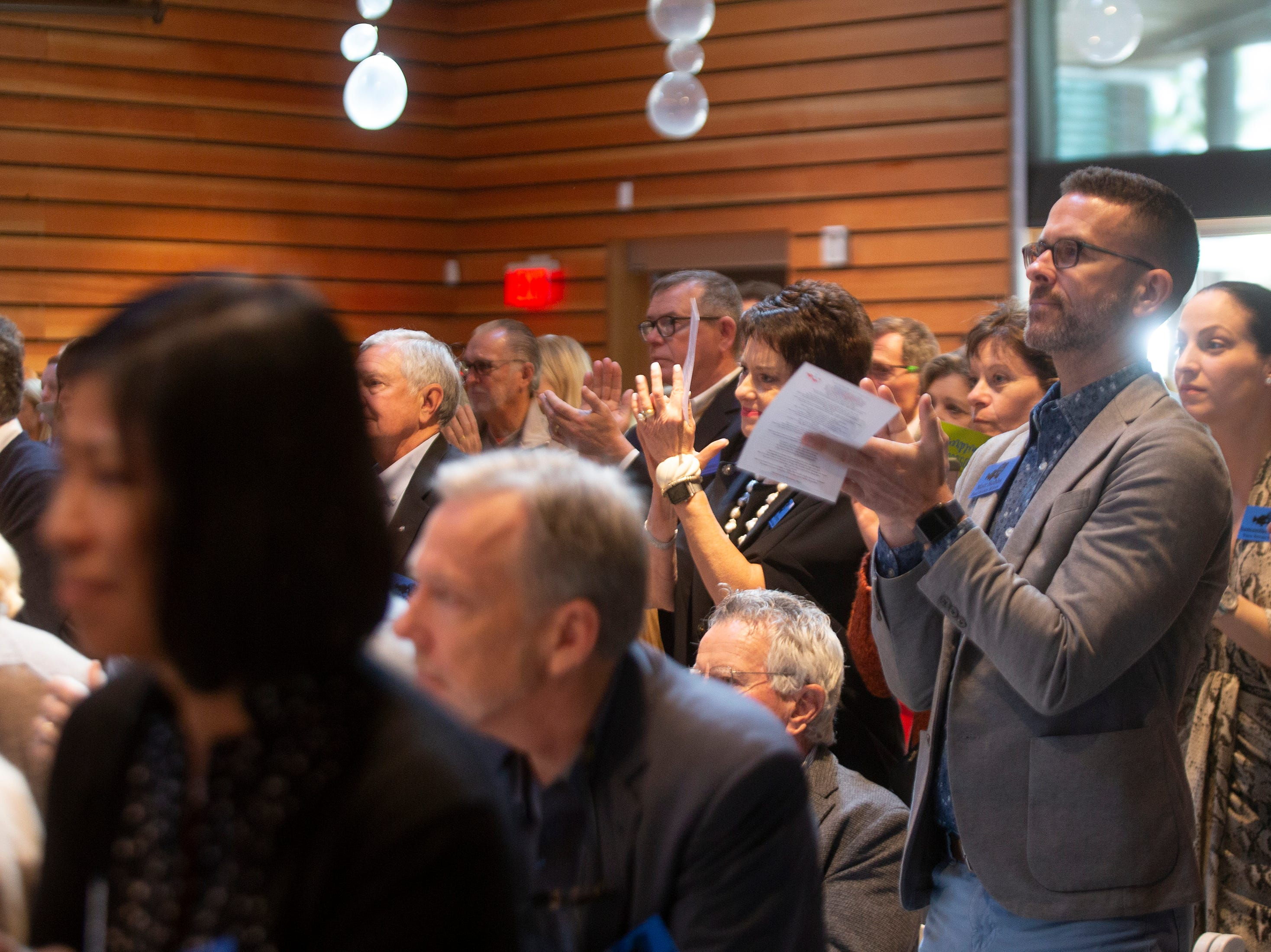 Patrons applaud as presenters talk during the Naples Winter Wine Festival Meet the Kids Day program Friday, Jan. 25, 2019, at Naples Botanical Garden.