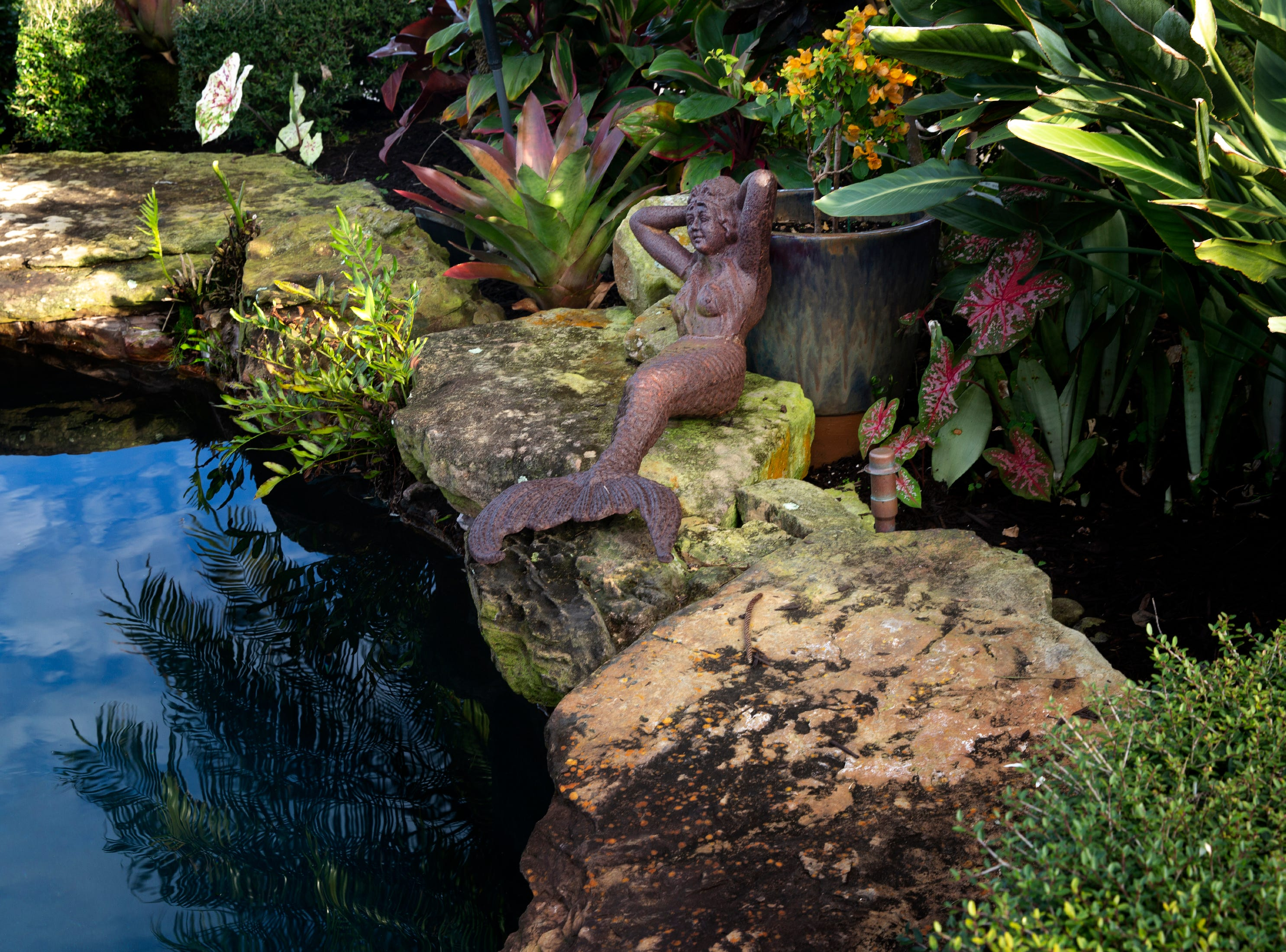 A statue of a mermaid sits near the pool of a Aqualane Shores home which will be featured in the Naples House and Garden Tour, Thursday, Jan. 25, 2019, in Naples.