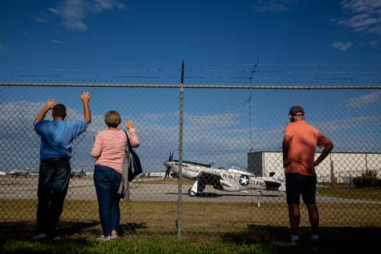 People observe a restored TF-51D Mustang (551CF) during the annual Collings Foundation's Wings of Freedom tour at Naples Airport on Friday, Jan. 25, 2019.