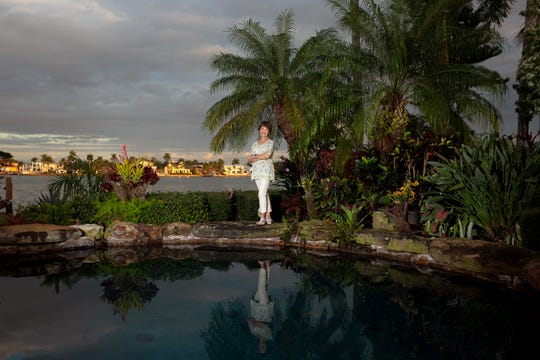 Linda LaRue Brown, the owner of a waterfront Aqualane Shores home which will be featured in the Naples House and Garden Tour poses for a portrait, Thursday, Jan. 24, 2019, at her home in Naples.