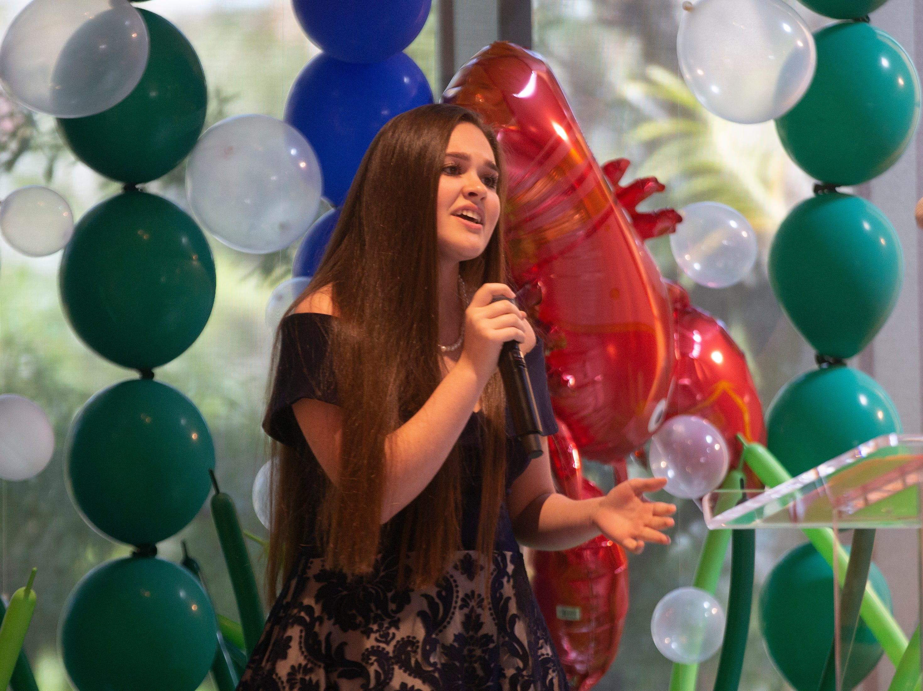 Madeleine Howe sings during a program for the Naples Winter Wine Festival Meet the Kids Day on Friday, Jan. 25, 2019, at Naples Botanical Garden.