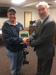 """Mayor Michael Compton presents his second """"Behind the Scenes Citizens of the Year"""" recognitionto Jim George."""