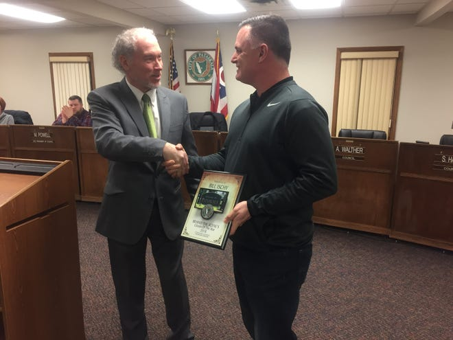 """Mayor Michael Compton presents his """"Behind the Scenes Citizens of the Year"""" recognitionto Bill Ischy."""
