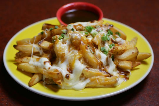 The duck fat disco fries at Twisted Elm are smothered in gravy and melted mozzarella cheese.