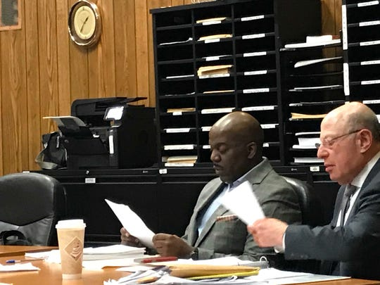 Derrick Chestnut ( L ), with his attorney John Weichsel at the defense table on Friday.