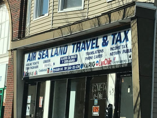 """Airs Sea Land Travel & Tax in Kearny no longer has the word """"immigration"""" on its outdoor sign, instead replaced with the word """"payroll"""" on Friday, January 25, 2019. The business was one of several cited last year  for allegedly defrauding customers by charging for immigration services that they are not legally permitted to provide."""