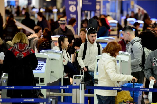 Travelers checking in for their flight at Newark Airport, Friday January 25, 2019.
