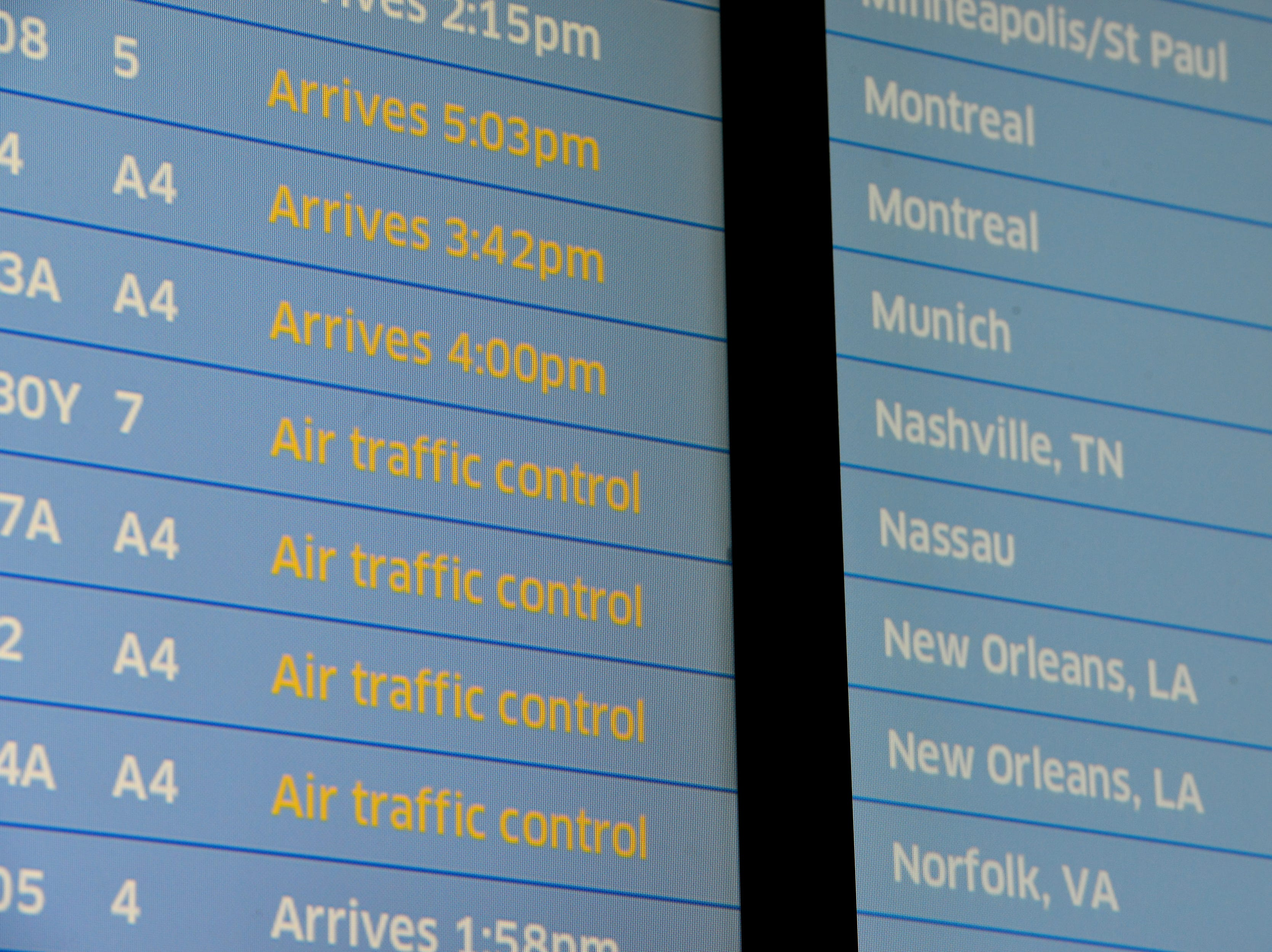 The arrivals board shows air traffic control delays at Newark Airport. Some traveller experienced the effects of the Federal shutdown while traveling in and out of the airport in Newark, Friday January 25, 2019.