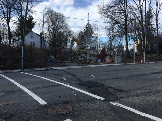 Workers demolish Cedar Grove's South End Firehouse on Jan. 25, 2019.