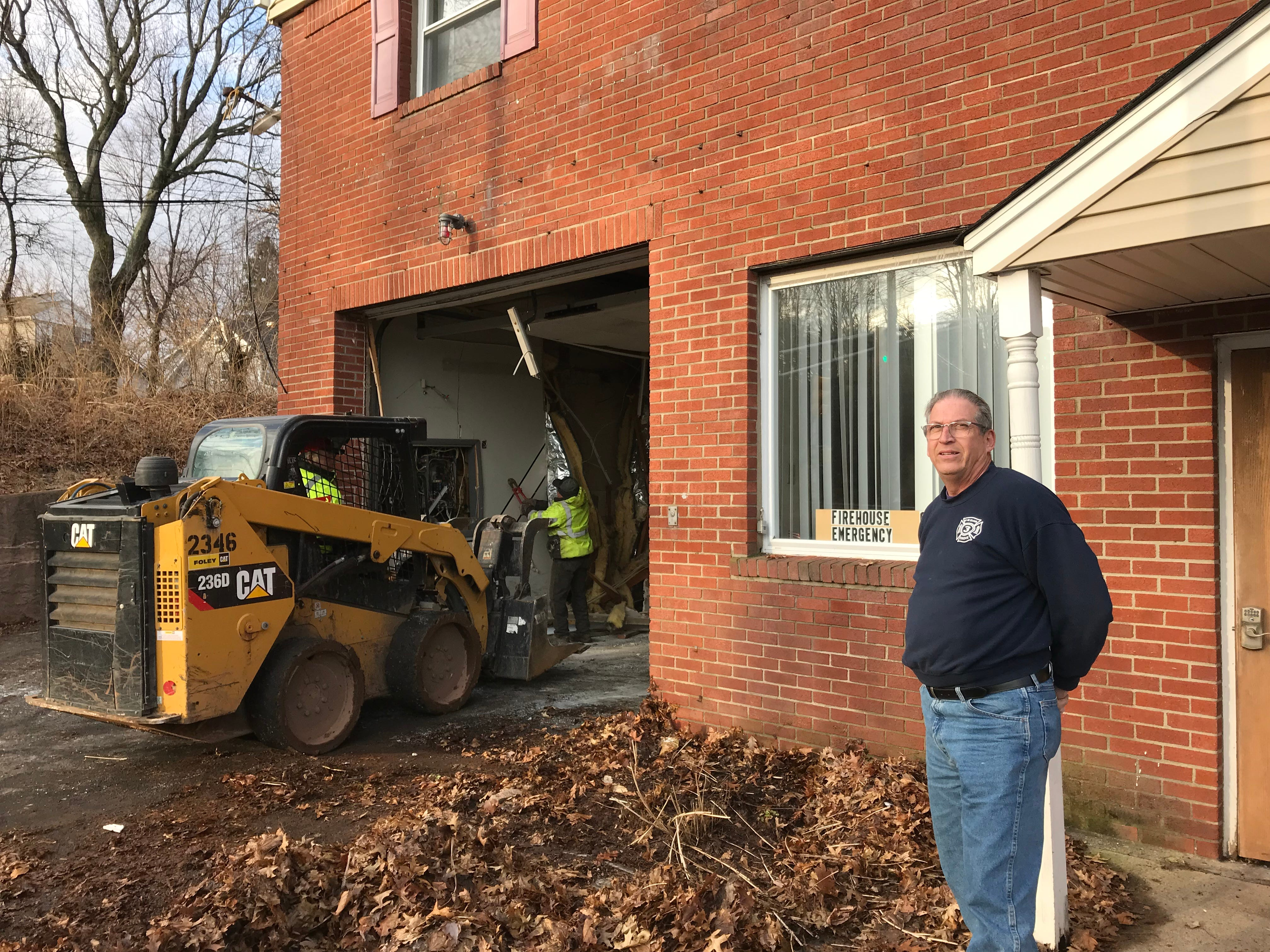 Cedar Grove Engine Company 3 President Mike Flohn watches as workers begin demolishing the South End Firehouse on Jan. 25, 2019.