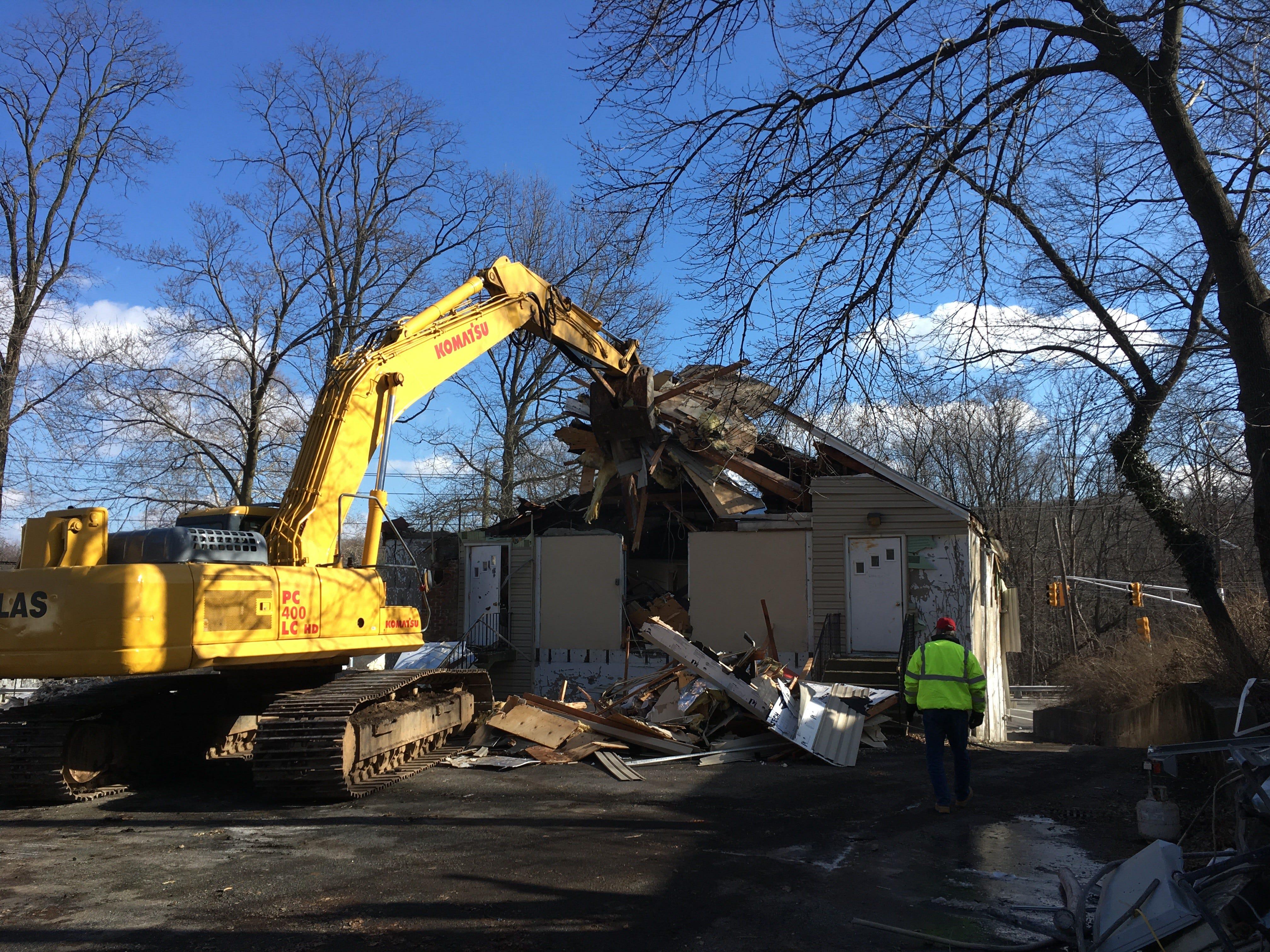 A grapple tears into the rear of Cedar Grove's South End Firehouse on Jan. 25, 2019.