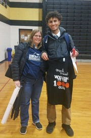 Mark Howell of Wayne Valley with his mother Barbara after reaching 1,000 career points.