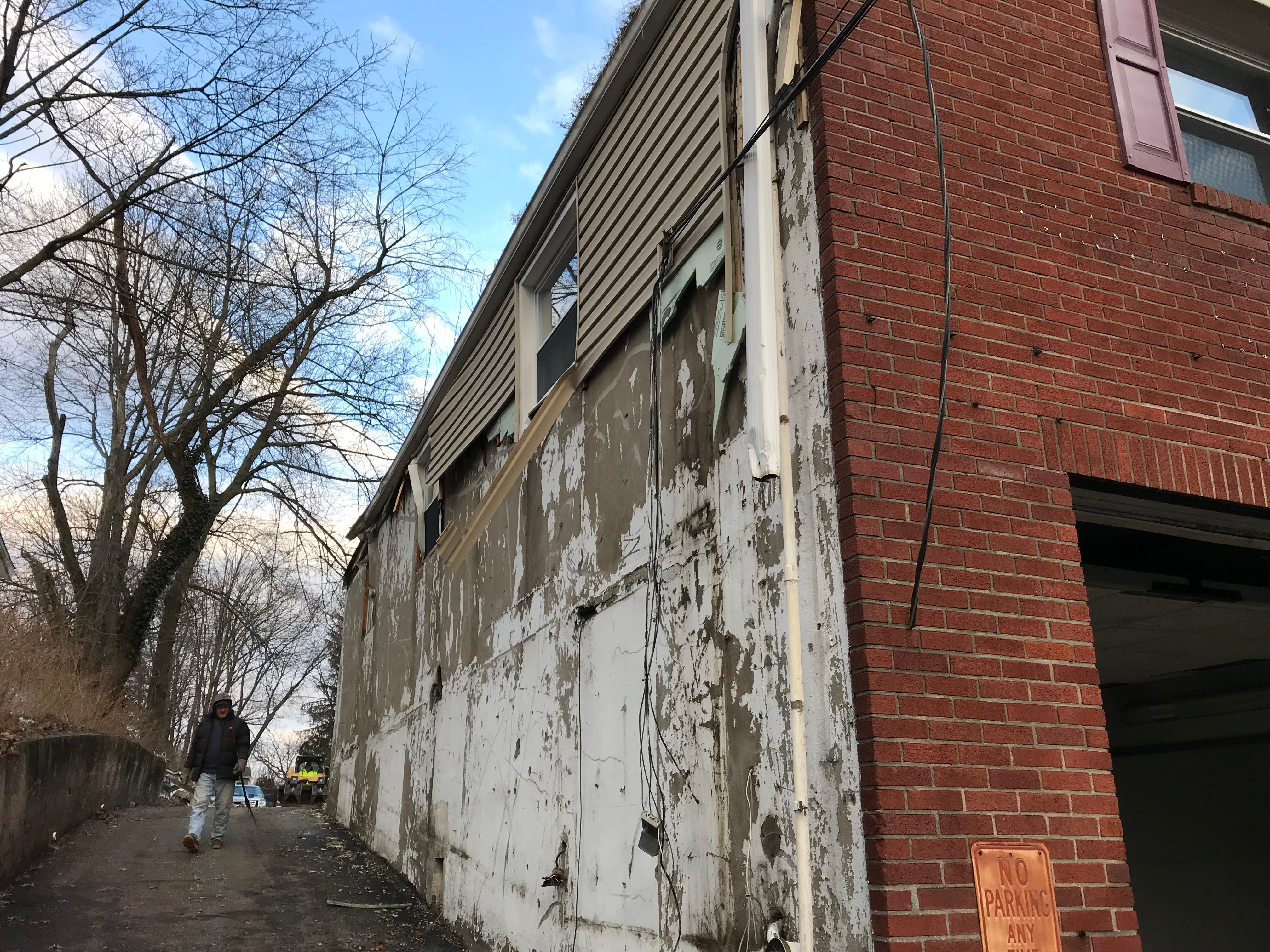The south side of the South End Firehouse is stripped before the Cedar Grove structure's demolition on Jan. 25, 2019.
