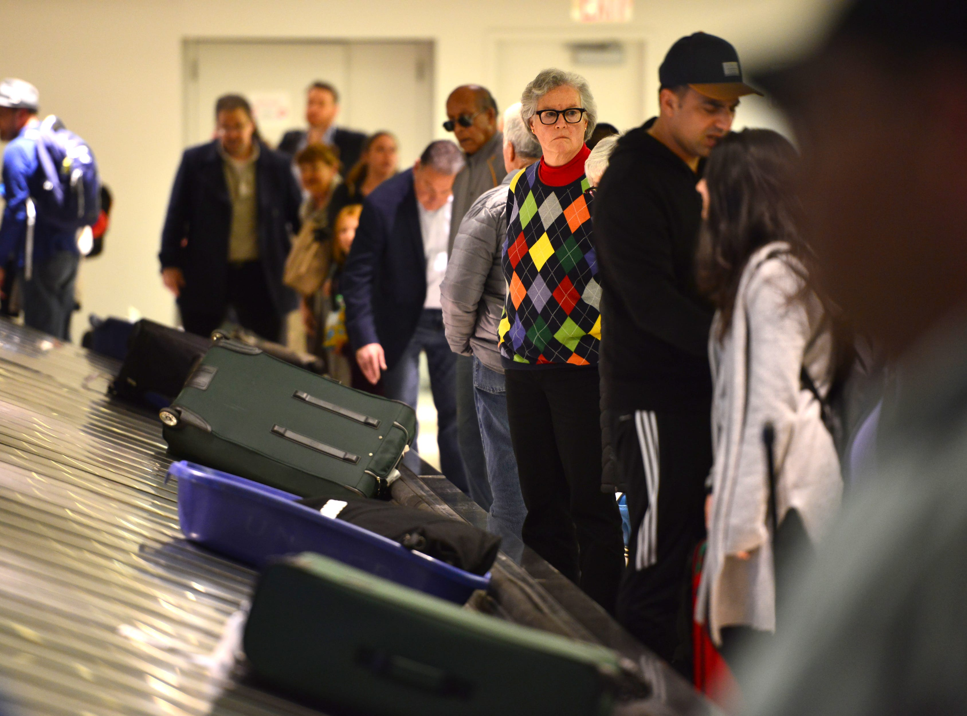 Travelers wait for their luggage at Terminal C at Newark Airport. Some traveller experienced the effects of the Federal shutdown while traveling in and out of the airport in Newark, Friday January 25, 2019.