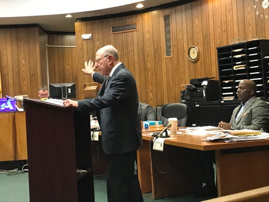 John Weichsel during his summation, with defendant Derrick Chestnut seated.