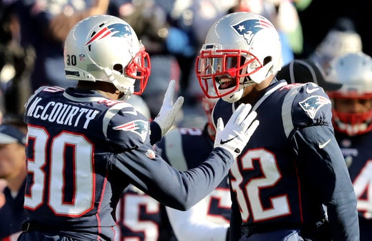 Jason McCourty, left, of the New England Patriots and twin brother Devin McCourty.