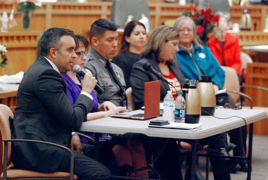 Bernalillo County District Attorney Raul Torrez of Albuquerque, left, testifies in support of a bill to expand background checks on nearly all private gun sales, Thursday, Jan. 24, 2019, in Santa Fe, N.M.
