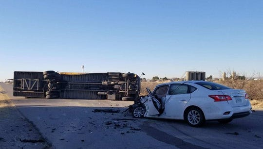 New Mexico State Police say a Nissan Sentra ran a stop sign and collided with a school bus Wednesday morning south of Carlsbad.
