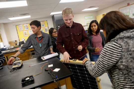 Students Sky Harper, left, Keona Hosteen, Xander Jones, Miauaxochitl Haskie and teacher Yolanda Flores look over the components for a solar project for last year's Lexus Eco Challenge on Feb. 28, 2018, at Navajo Preparatory School in Farmington.