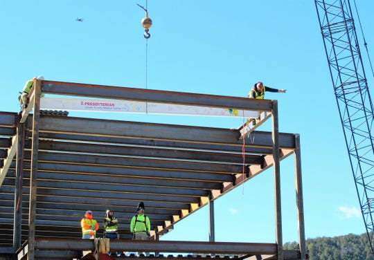 The signed beam is fitted into place.
