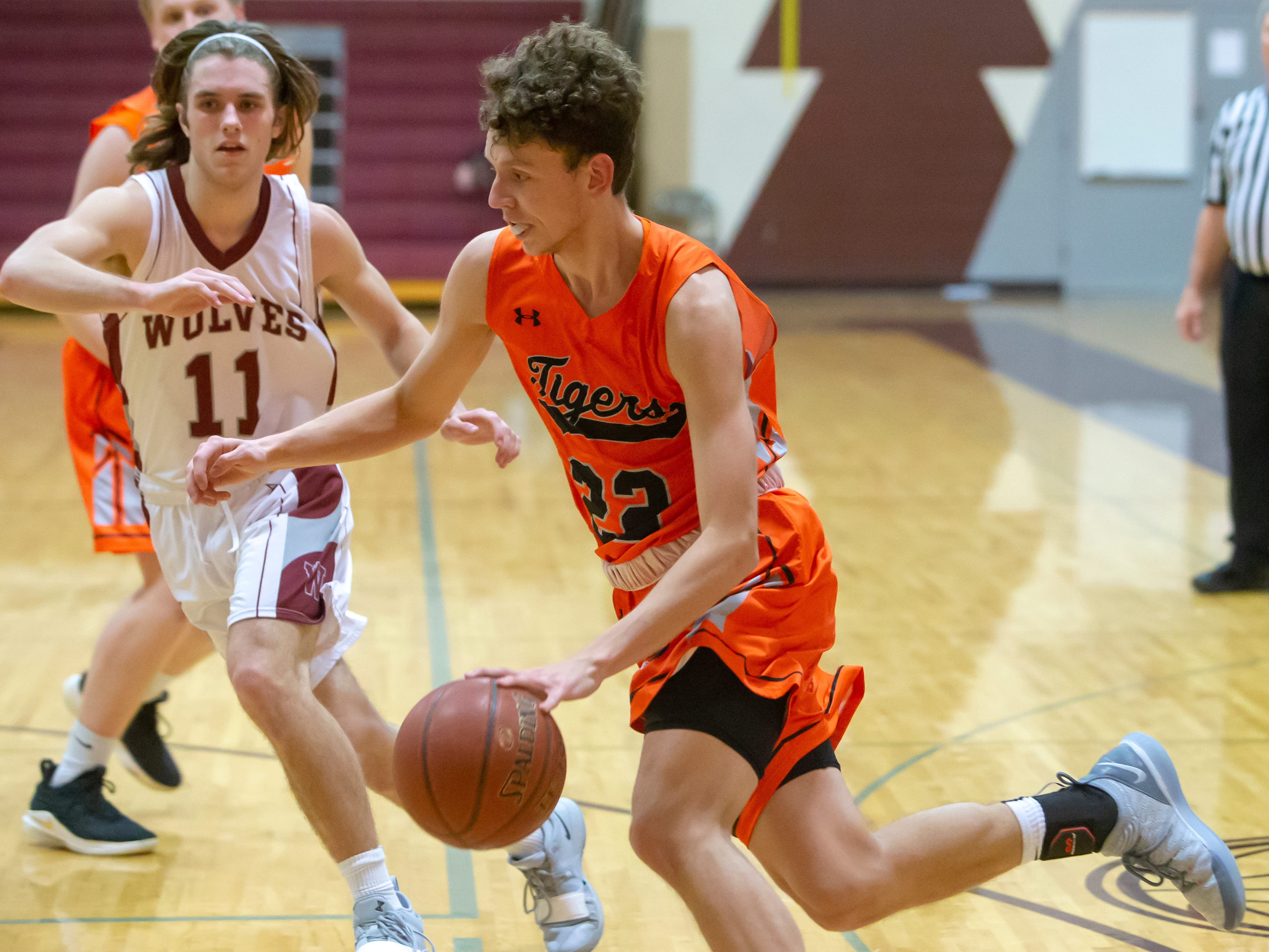 Ripon's Max Beuthin drives the ball to the basket during a game against the Wolves at Winneconne High School on Thursday, January 24, 2019.