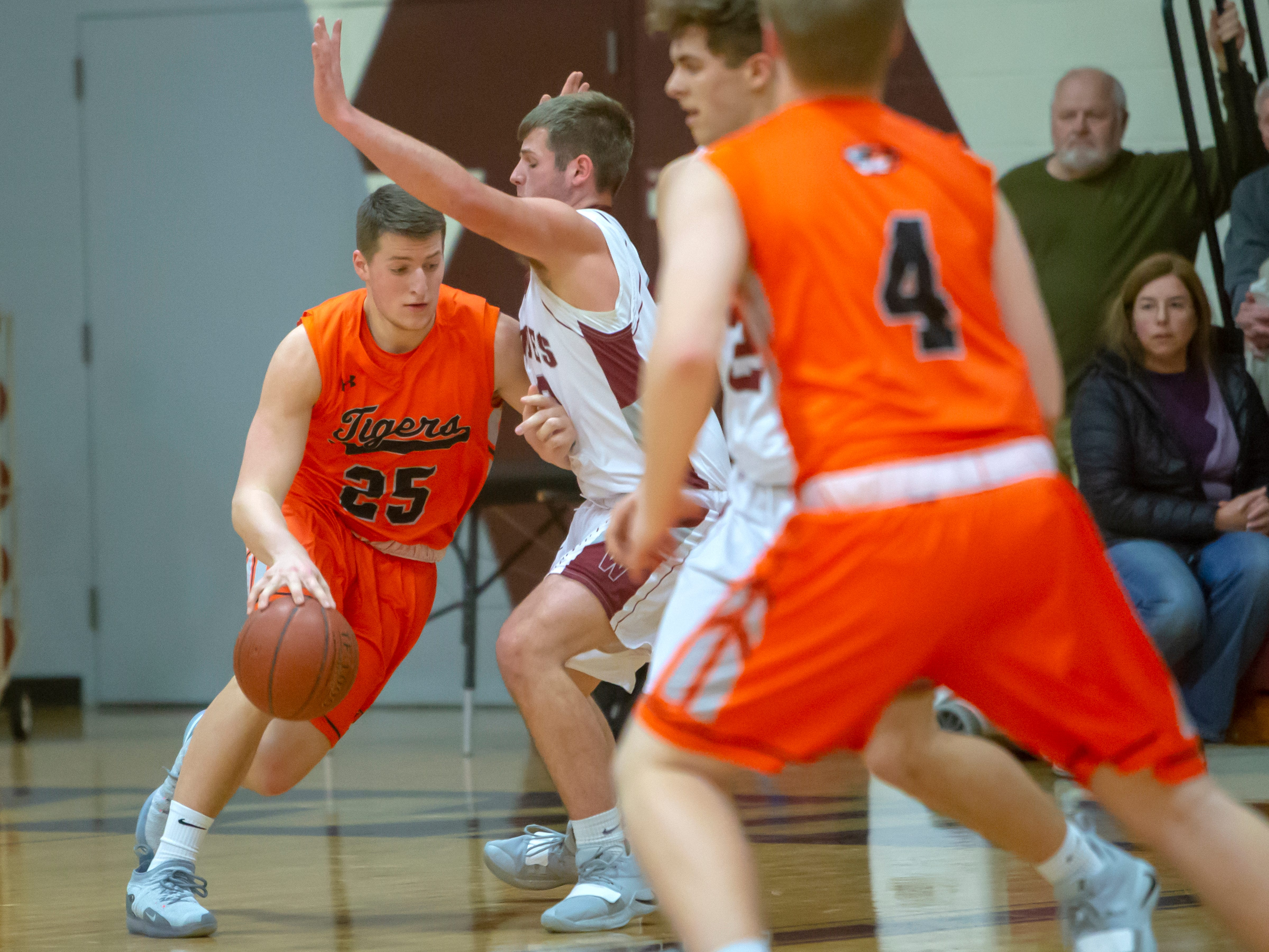 Ripon's Hunter Schneider drives the ball around Winneconne's Andrew Jensen at Winneconne High School on Thursday, January 24, 2019.